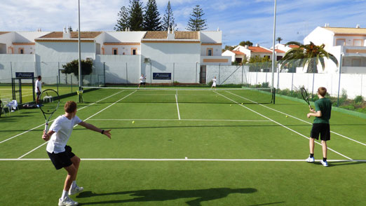 Family plays tennis on the Luz Bay Hotel courts