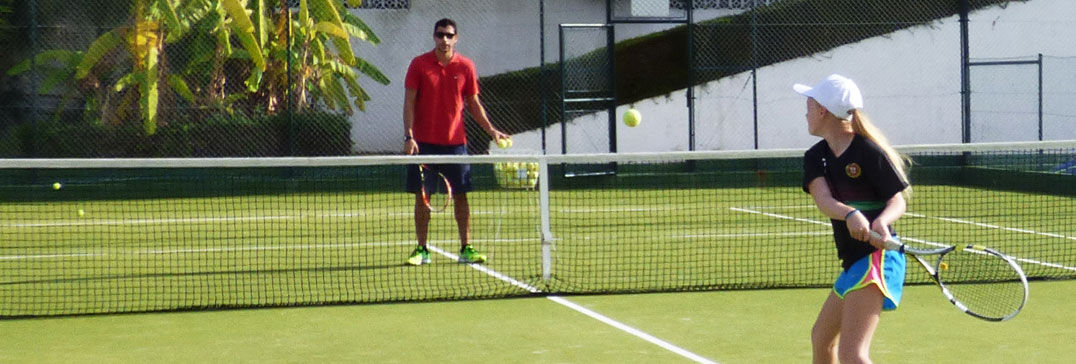 Child playing tennis, Algarve Family Holiday