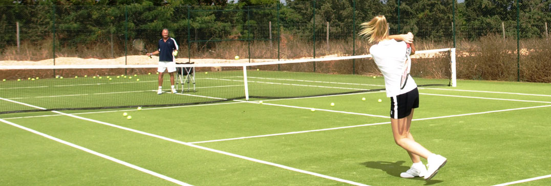 Tennis coaching on the astro turf, Algarve