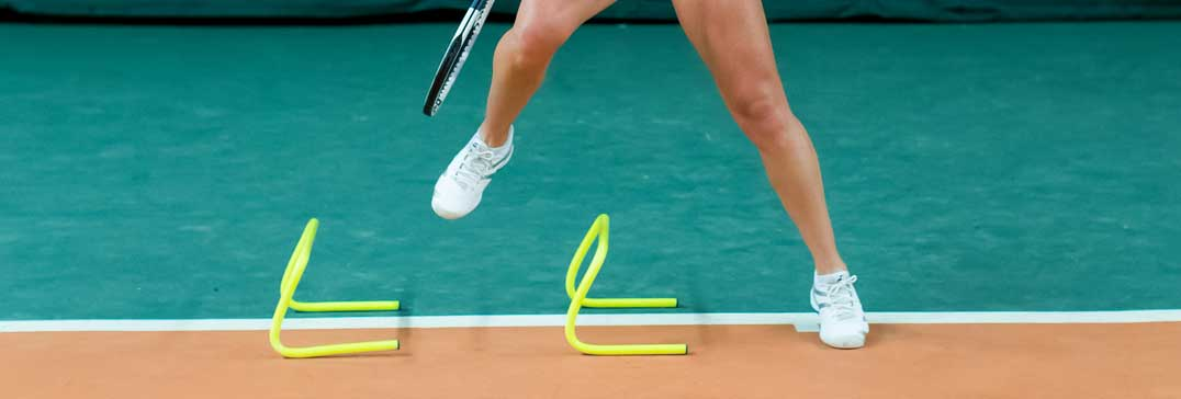 Tennis player and hurdles