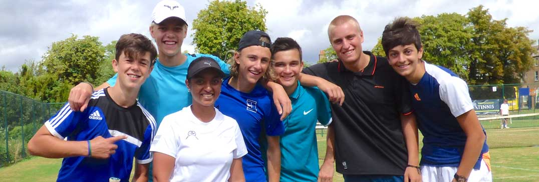 Trainee tennis coach with players