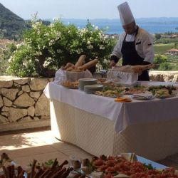 Food being served in front of Lake Garda