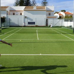 Doubles match on the Luz Bay Hotel courts