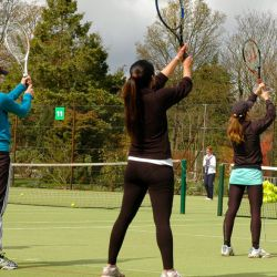 Adult tennis players on court