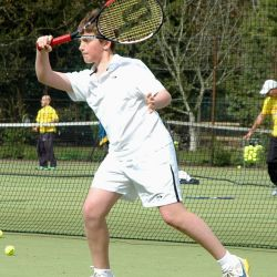 Teenage player hitting a forehand, at London Tennis Clinic