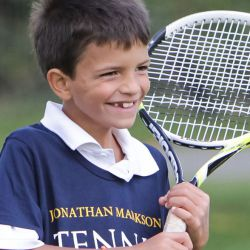Young tennis player with a smile
