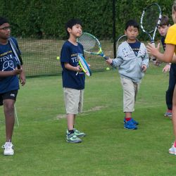 Young tennis players receiving coaching, Oxford