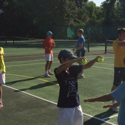 Young tennis players warm up