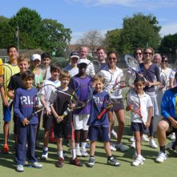Children and adult players at the London Tennis Clinic